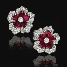 Pair of ruby and diamond ear clips, Van Cleef & Arpels, 1952 - Sotheby's