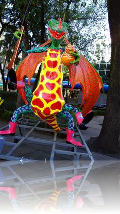 ALEBRIJES (brightly-colored Oaxacan-Mexican folk art sculptures of fantastical creatures)