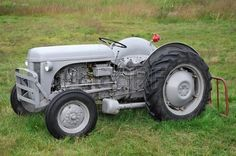 Vintage Rusty Tractor Abandoned In Farm Field Stock Photo, Picture ...