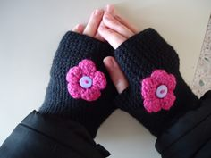 Crochet fingerless gloves with a decorative flower