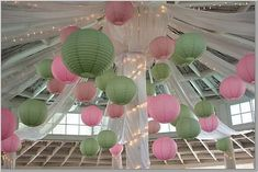 Paper lanterns in pink and green.
