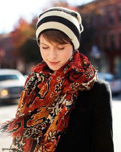 Striped beanie, printed scarf, black jacket / Garance Doré