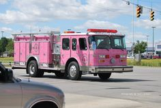 I caught this shot on US Highway 31 in Kokomo, Indiana on Saturday Sept. 4th, 2010 as a police escort came whizzing by me and 3 pink fire trucks followed. Looks like it might be related to breast cancer awareness. The truck looks to have autographs all over them. Firetruck