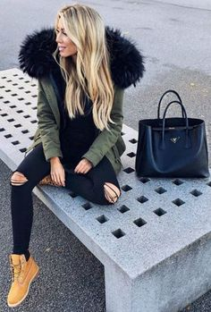 Janine Wiggert + casually chic + understated winter style + pair of distressed denim jeans + furry green parka + pair of gorgeous classic timberlands + simplicity of this look!  Brands not specified.