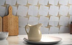 We guarantee you'll love with our new spring collections. Have your pick of decorative porcelain, stone tile inlaid with brass, metallic glazes, and more.