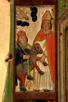 Eligius van Noyon -Eligiusaltaar : onder inspiratie van de Heilige Geest pakt hij ben van vorstelijk paard. ca 1660, houtsculptuur. Frankrijk, Bretagne, Berven, Chapelle Notre Dame.