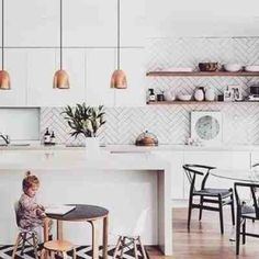 Love the pendant lights,  the houndstooth backsplash, and open shelving