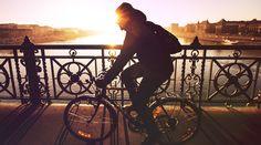 Man on bike riding along boardwalk