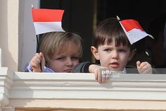 Sacha Casiraghi (L) and Raphael Casiraghi (R) appear on the balcony of the Monaco Palace during the celebrations marking Monaco's National Day, on November 19, 2016 in Monaco. / AFP / VALERY