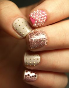 Gorgeous pink nail with pearls; small gold beads on nude nail; pink glitter and sparkles.