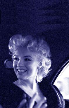 """Wanna split a cab?"" Marilyn Monroe in transit."