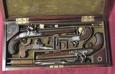 "Cased Pair of Flintlock Dueling Pistols & Seconds Pistols. .63 caliber dueling pistols, .52 caliber ""second"" pistols for the associates. By Phillip Bond."