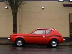 1973 AMC Gremlin......don't be jealous, but I use to drive one similar to this.......a total babe magnet!