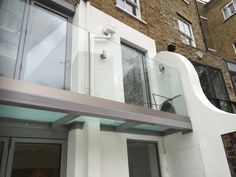 Walk out balcony design complete with glazed floor and infinity frameless glass balustrade design.
