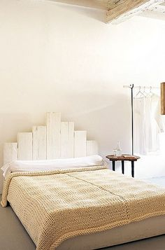 white painted wood headboard. barefootstyling.com
