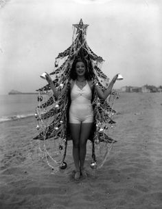 Woman dressed as a Christmas tree on a Southern California beach - 1936