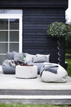 A Rocket Daybed covered in Sunbrella's outdoor coated canvas fabric is waterproof and resistant to mold and fading (and is available in four neutral colors);