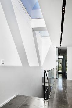 Design touch switch by Basalte in white contemporary villa in Denmark. Made in Belgium.