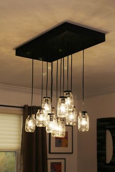 DIY-do this but instead of mason jars, create crystal shades, or use little paper chinese lantern shades, or even regular shades. You can make this what ever colors you like as well. Pot Mason Diy, Mason Jars, Diy Luminaire, Luminaire Design, Mason Jar Chandelier, Mason Jar Lighting, Diy Chandelier, Chandelier Creative, Mason Jar Light Fixture