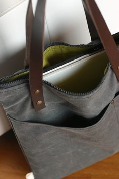 Handmade waxed canvas bag with first quality italian leather handles  This waxed cotton bag is perfect to carry your laptop and has a pocket