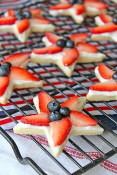 Only 3 ingredients in the cookies, followed by 2 in the icing & 2 fruits to top them. The buttery shortbread cookies hold their shape perfectly w/a nice crunch & slight chew. The icing is simple & sweet. And the fruit makes them super festive. How cute would these look on your 4th of July table? 1-1/4 cups Gold Medal® all-purpose flour 1/4 cup sugar 1/2 cup (1 stick) butter, softened 4 ounces cream cheese, room temperature 1/4 cup powdered sugar 24 strawberries, thinly sliced 1 cup blueberries