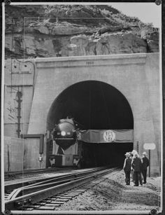 Here's a shot of the first train through Elkhorn Tunnel in West Virginia in 1950. www.nscorp.com