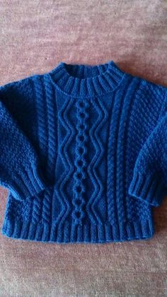 This lovely hand-knitted piece is perfect for cold days! Made of merino wool, in traditional Aran stitches. For years old toddler. New, with tags, ready to ship. Can be made in different size and/or color. Baby Boy Knitting Patterns Free, Aran Knitting Patterns, Baby Cardigan Knitting Pattern, Knitting Designs, Knit Patterns, Aran Sweaters, Knit Baby Sweaters, Girls Sweaters, Baby Girl Cardigans