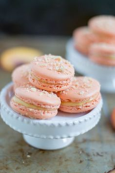 These peach cobbler macarons are Southern decadence meets Parisian chic.  French Macarons are notorious finicky and I cannot clam to be an expert but  after tossing several full batches of failed attempts in the trash, reading  tons of recipes/tutorials, and experimenting, this is what I've come