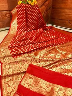 Try this eternal beauty for the next event. This perpetual appeal of Bright Red color Banarasi Saree with pure Golden Zari Weaving is never going to fade. The intricate weaving offer you the elegance and bring our the charisma. Kuppadam Pattu Sarees, Banarsi Saree, Lehenga, Georgette Sarees, Indian Bridal Sarees, Bridal Silk Saree, Red Chiffon, Red Silk, Red Saree Wedding