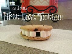 """Before the Tooth Fairy arrives, celebrate a first lost tooth with a fun sweet treat! All you need is chocolate chip cookies, white icing and mini marshmallows. Be sure to leave a """"tooth"""" out for the full effect!"""