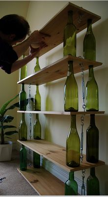 i could do this Quick & Dirty Repurposed Shelving Wine Bottles + wood + hardware tackle = crafty bookshelf. Empty Wine Bottles, Recycled Glass Bottles, Wine Bottle Art, Wine Bottle Crafts, Beer Bottles, Recycle Wine Bottles, Wine Bottle Fence, Wine Bottle Lanterns, Cutting Glass Bottles