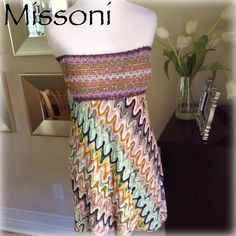 """Authentic designer MISSONI strapless mini Yup this is authentic designer MISSONI!! Wear that iconic fabric that tells everyone your wearing something cool & VERY expensive! Wear as a mini dress, long top or swim coverup! Approx 5 3/4"""" tall elastic banded bust w/ embroidery & tiny sequins sewn in. Empire waist w/ Missoni's iconic print in a soft knit. Skirt portion is lined w/ a sage green fabric. Worn 2x great condition. Approx measurements laying flat: overall length:24""""/ under bust band to…"""