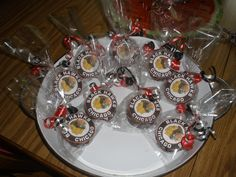 """Chicago Blackhawks Dessert Pucks""  I used Little Debbie Cakes (AKA Ding Dongs) Put in a Wilton Party Bag Attached ribbon Printed logo onto Avery Round Labels & Attached to the outside of bag  **Hint I froze the cakes first Great for Stanley Cup Party"