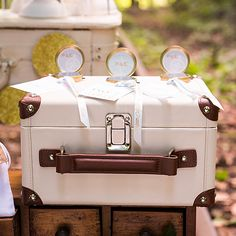Here is a custom designed Wishing Well that is ideal for the wedding couple with a passion for travel. The miniature Suitcase styling has a touch of vintage flair with contrasting ivory and brown faux leather covering and tag. This will serve as the perfect container for notes of well wishes prepared by your wedding guests.  Available for purchase online at http://madelinesweddings.weddingstar.com/product/mini-suitcase-wishing-well