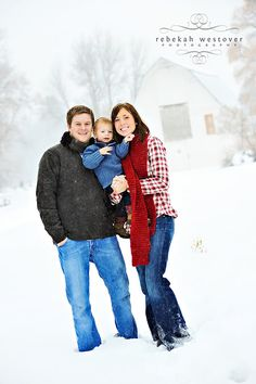 winter family photo with barn