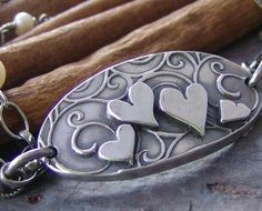 The focal piece is formed by hand from fine silver clay(PMC) and is thick and very solid! Th artist hand cuts the oval swirl design, and then cuts and hand applies each little heart. Metal Clay Jewelry, Polymer Clay Jewelry, Precious Metal Clay, Clay Design, Heart Jewelry, Jewelry Crafts, Jewelry Ideas, Precious Metals, Hand Stamped