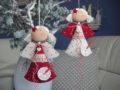 Angels head appear to be cloth covered buttons, dress seems to be felt or cloth cones, very cute with pigtails and barrettes