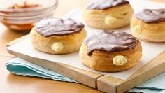 A quick cannoli style cream filling takes these delicious chocolate glazed doughnuts to the next level.