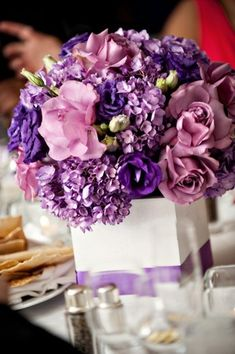 Purple Centerpieces - simple and pretty.  Maybe in a clear square vase filled with transparent stones?