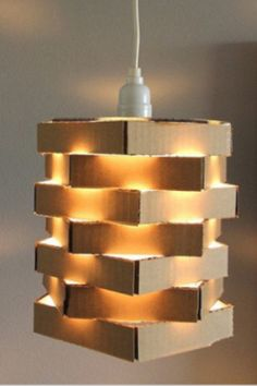 For DIY Thursday, we are featuring this DIY cardboard pendant lamp. All you really need is some stray cardboard boxes and glue! Check out the 5 steps to making this DIY project. Diy Cardboard Furniture, Cardboard Crafts, Cardboard Boxes, Cardboard Design, Cardboard Playhouse, Chandelier Lamp, Pendant Lamp, Pendant Lights, Cardboard Chandelier