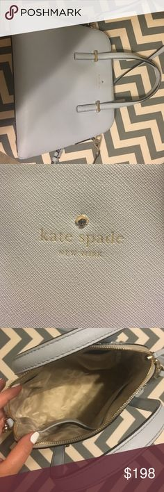 Authentic Kate Spade blue cedar street handbag Light blue, gently used like new. Still on Kate spade website. Purchased in April 2016. Long strap and dust bag included. kate spade Bags Shoulder Bags