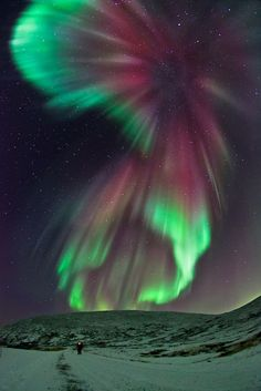 An absolute fantastic auroral outbreak captured at Rekvik mountain, close to Tromsø.