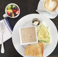 Egg white and turkey bacon omelette topped with avocado.Toast +steel cut oats a small side of fruit + latte.