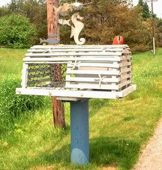 ღღ Lobster trap mailbox on Prince Edward Island, Canada. Seen at PEI Blog.