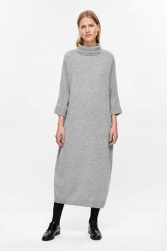 A casual style, designed with oversized proportions, this dress is made from a fine knitted soft wool. Loosely fitted, it has a high-neck collar, 3/4 sleeves and tightly ribbed finishes.