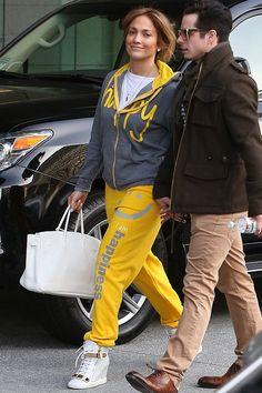 Jennifer Lopez wearing Hermes Birkin in White Giuseppe Zanotti Spring 2013 Metal Plate Sneakers Peace Love World I Am Happy Chrome Zip hoodie Peace Love World I am Happiness L2L Smile Pants