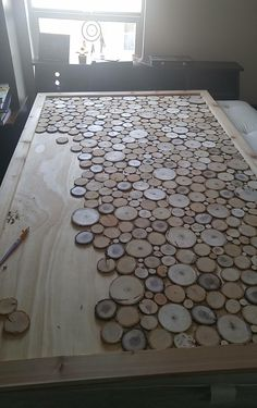 Wood slice headboard in the works... of table.