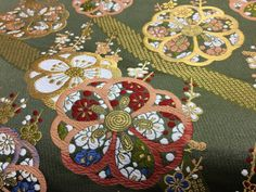 Japanese golden and green brocade fabric by japanmomijidesigns