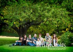 Large family photo, love the setting with the tree and lighting