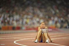 Romania Angela Morosanu (2707) sitting on track from exhaustion after Women's 400M Hurdles Round 1 - Heats at National Stadium ( Bird's Nest ). Beijing, China 8/17/2008